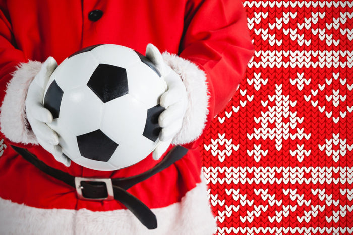 Festive Fixtures: Santa Holding a Football