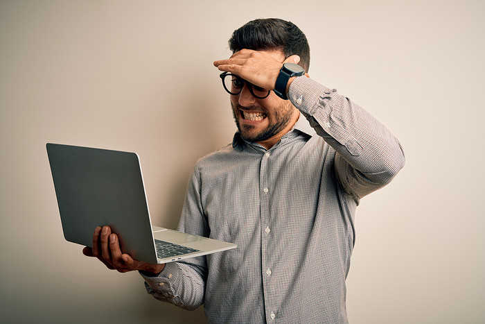 Man with Laptop Having Made a Mistake