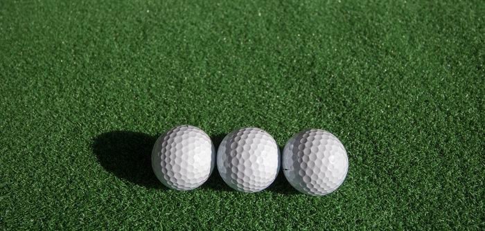 Three Golf Balls Side by Side