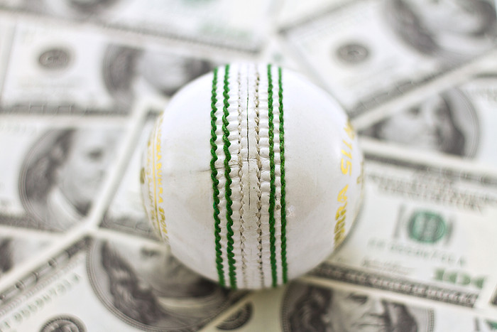 Cricket Ball on 100 Dollar Bills