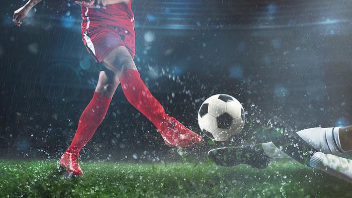 Football Tackle in Rain