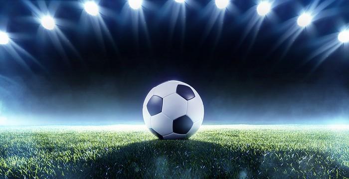 Football Illuminated by Floodlights