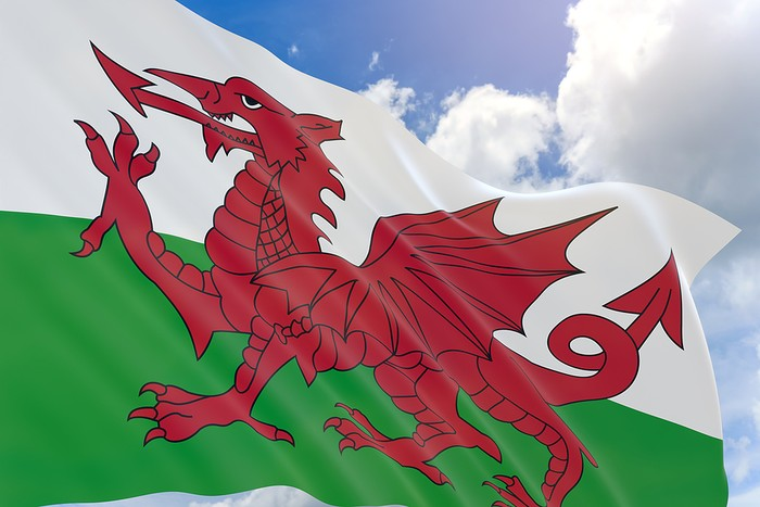 Wales Flag Against Blue Sky