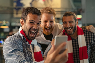 Football Fan Friends Cheering Holding Phone