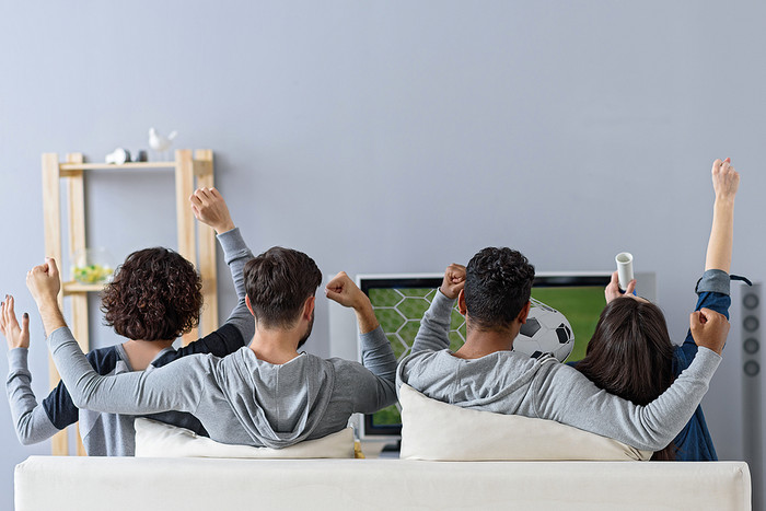 Friends Cheering Watching Football on TV