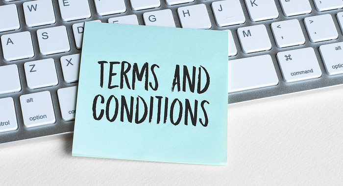 Terms and Conditions Post it Note on Keyboard