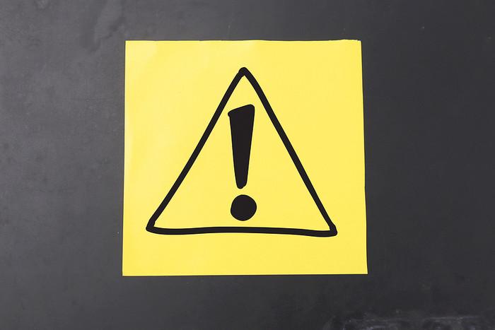 Warning Triangle on Sticky Note