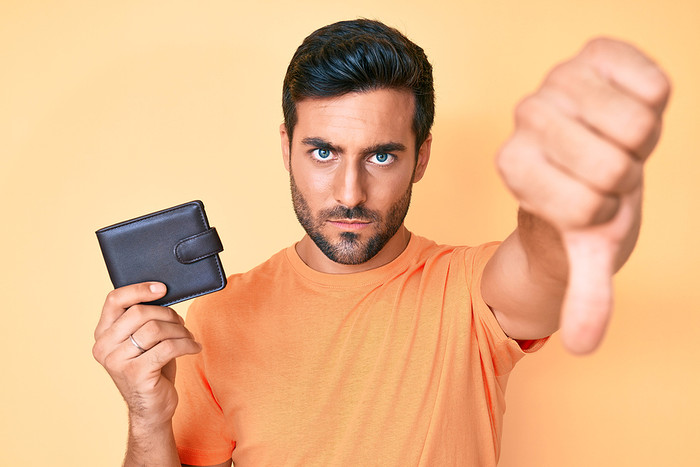 Man Holding Wallet with Thumbs Down