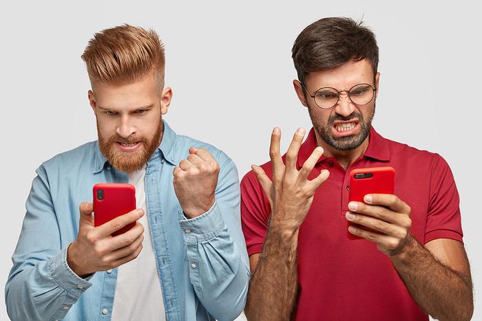 Two Friends Watching Smartphones