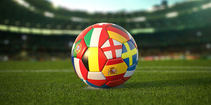 Football With Country Flags on Grass