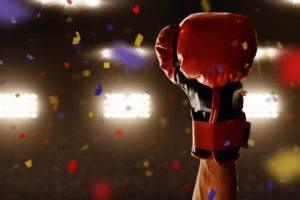 Boxer Holding Red Glove in the Air