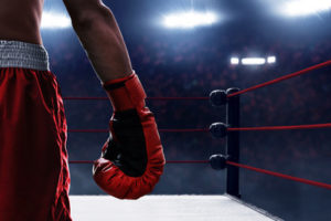 Boxer in Ring with Red Gloves and Shorts