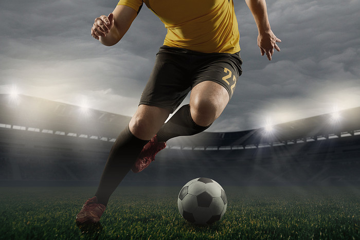 Footballer in Green and Gold Kit