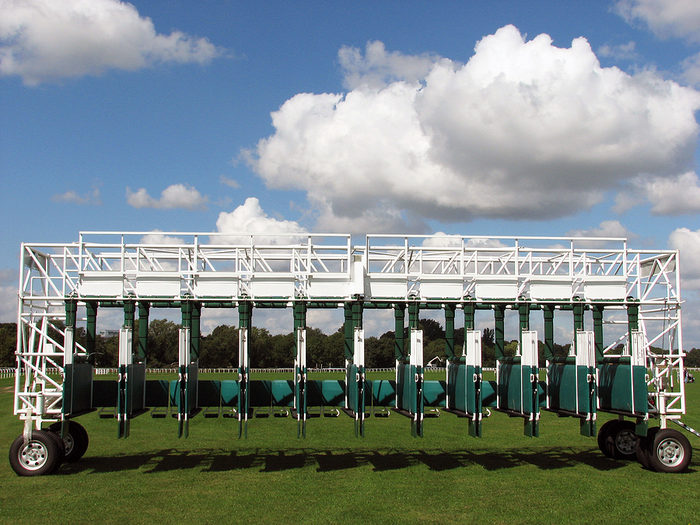 Horse Racing Starting Stalls Against Cloudy Sky