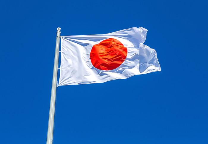 Japanese Flag Against Blue Sky