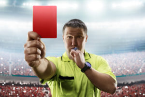 Referee Blowing Whistle Showing Red Card
