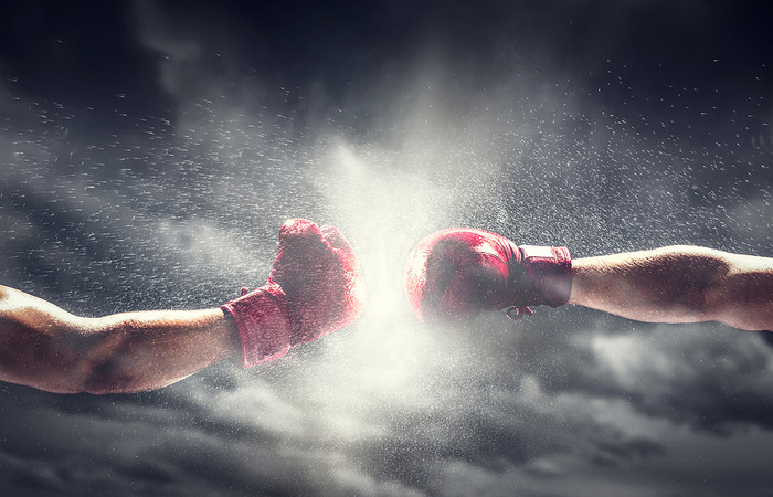 Two Boxing Gloves Punching