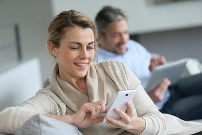 Couple Using Smartphone and Tablet