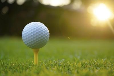 Golf ball on Yellow Tee