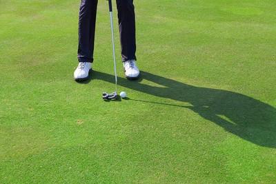 Golfer Standing on Green